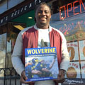 Denard Robinson with University of Michigan football gift picture book WOLVERINE: A Photographic History of Michigan Football, Vol. 1