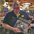 Jim Brandstatter with University of Michigan football gift picture book WOLVERINE: A Photographic History of Michigan Football, Vol. 1