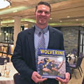 Jon Jansen with University of Michigan football gift picture book WOLVERINE: A Photographic History of Michigan Football, Vol. 1